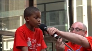 Third grader Asean Johnson openly calls the school closings racist at a rally on Daily Plaza this past Monday.